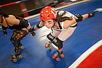 The Hellcats and Putas del Fuego, both of TXRD, or Texas Roller Derby in Austin, Texas, at practice.