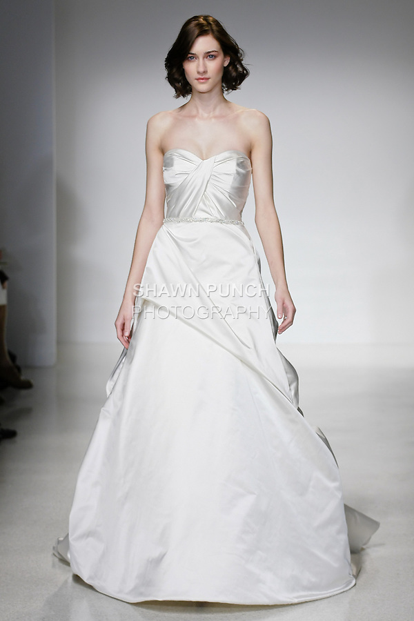 Model walks runway in a Thalia wedding dress by Amsale Aberra, for the Christos Spring 2012 Bridal runway show.