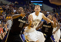 California's Max Zhang (14) battles for the rebound between Washington's Matthew Bryan-Amaning (11) and Isaiah Thomas (2) off Jerome Randle's free throw in the final seconds of the game. The Washington Huskies defeated the California Golden Bears 79-75 during the championship game of the Pacific Life Pac-10 Conference Tournament at Staples Center in Los Angeles, California on March 13th, 2010.