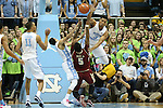 30 January 2016: North Carolina's Marcus Paige (5, white) is called for a foul on Boston College's Garland Owens (5, maroon) as North Carolina's Kennedy Meeks (3) swats the ball away. The University of North Carolina Tar Heels hosted the Boston College Eagles at the Dean E. Smith Center in Chapel Hill, North Carolina in a 2015-16 NCAA Division I Men's Basketball game. UNC won the game 89-62.