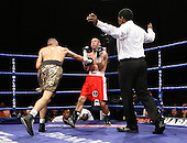 Akaash Bhatia (Harrow, gold shorts) defeats John Vanemmenis (Bridgwater, red shorts) in a Featherweight contest at Goresbrook Leisure Centre, Dagenham, Essex promoted by Frank Maloney / FTM Sports - 18/07/08 - MANDATORY CREDIT: Gavin Ellis/TGSPHOTO - Self billing applies where appropriate - Tel: 0845 094 6026.