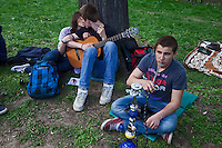Moscow, Russia, 12/05/2012..Two protesters kiss whie another smokes a hookah pipe in Chistiye Prudy, or Clean Ponds, a park in central Moscow were some 200 opposition activists have set up camp.