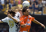 Chiapas Jaguares defender Felipe Ayala (R) heads the ball against UNAM Pumas strikers Bruno Marioni (L) and Leandro Augusto (behind) during their soccer match at the University Stadium, April 02, 2006. UNAM Pumas won 2-1 to Chiapas Jaguares... Photo by © Javier Rodriguez