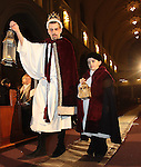 Waterbury, CT-04 January010409-010409MK02 (from left) Robert and Nicholas Deloy portray shepherds looking for the Christ child during the fourth annual Boars Head Festival at The Shrine of St. Anne in Waterbury Sunday afternoon. Michael Kabelka Republican-American