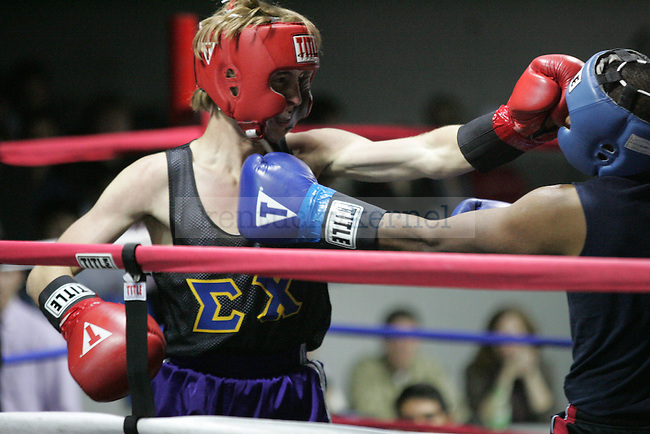 Rick Guha (R) of Phi Sig and Charlie Hunt (L) of Sigma Chi punch each other during their bout at The Main Event, where proceeds benefitted The Huntsman Cancer Institute and The Ronald McDonald House in Lexington, Ky. on 11/11/11. Photo by Quianna Lige | Staff