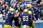 April 22, 2017; Running back Josh Adams (33) celebrates a touchdown in the 2017 Blue-Gold game. (Photo by Matt Cashore)