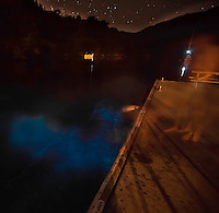 Jumping into the water at night created amazing luminescence. (Photo by Travel Photographer)