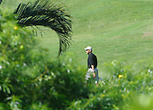 Kailua, Hawaii - December 24, 2008 -- United States President-elect Barack Obama walks over to hit golf balls on the driving range at Mid-Pacific Country Club in Kailua, Hawaii on Wednesday, December 24, 2008..Credit: Joaquin Siopack / Pool via CNP