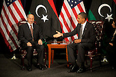 United States President Barack Obama, right, offers his hand to Chairman Mustafa Abdel Jalil of the Libyan Transitional National Council (TNC), left, at the United Nations in New York, New York on Tuesday, September 20, 2011..Credit: Allan Tannenbaum / Pool via CNP