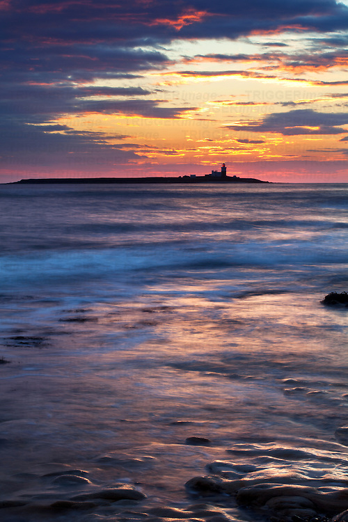 Light on the Sea and Coquet Island at Dawn Amble by the Sea Northumberland Coast England