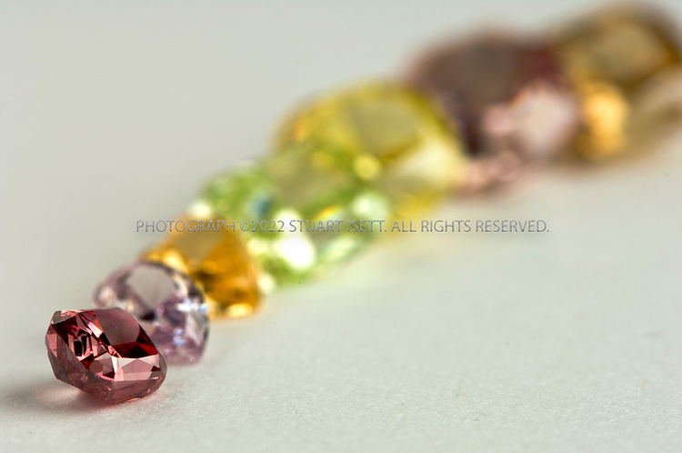 5/21/2007--Seattle, WA, USA..A collection of colored diamonds available from online diamond seller, Blue Nile...From left to right:.2A Red: $350,000  (in focus).Pear-purplish-pink: $8190.Heart-intense orange: $4268.2A Candy-apple-green: $375,000 .Vivid yellow: $37,076.Deep purple: $150, 332.Deep brown-orange: $9581