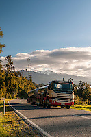 Milking truck on road at Lake Ianthe at sunset, West Coast, South Westland, South Island, New Zealand