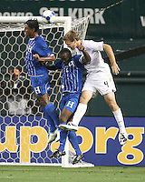 Chad Marshall #4 of the USA goes up for a header with Carlos Costly #13 and Osman Chavez #2 of Honduras during a CONCACAF Gold Cup match at RFK Stadium on July 8 2009 in Washington D.C. USA won 2-0.