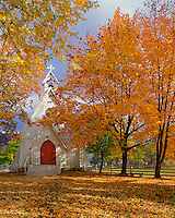 Ascension Chapel surrounded by autumn colors located in Cove Oregon