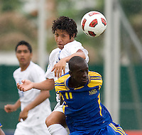 Ramon Amador (17) of Honduras goes up for a header against Jabarry Chandler (11) of Barbados during the group stage of the CONCACAF Men's Under 17 Championship at Catherine Hall Stadium in Montego Bay, Jamaica. Honduras defeated Barbados, 2-1.
