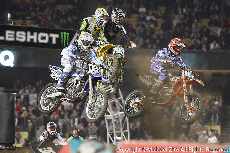 01/22/11 Los Angeles, CA:  Cyclists fly through the air during the 1st ever AMA Supercross held at Dodger Stadium.