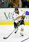 9 January 2011: University of Vermont Catamount forward Anthony DeCenzo, a Freshman from Hibbing, MN, in action against the Boston University Terriers at Gutterson Fieldhouse in Burlington, Vermont. The Catamounts fell to the Terriers 4-2 in Hockey East play. Mandatory Credit: Ed Wolfstein Photo