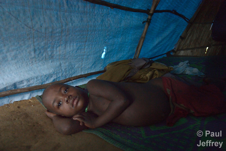 Janti John, 4, wakes up in his family's shelter in a camp for for than 5,000 displaced people in Riimenze, in South Sudan's Gbudwe State, what was formerly Western Equatoria. Families here were displaced at the beginning of 2017, as fighting between government soldiers and rebels escalated.<br /> <br /> Two Catholic groups, Caritas Austria and Solidarity with South Sudan, have played key roles in assuring that the displaced families here have food, shelter and water.<br /> The camp formed around the Catholic Church in Riimenze as people fled violence in nearby villages for what they perceived as the safety offered by the church.