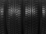 Closeup of a winter car tires background texture