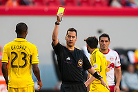 Referee Geoff Gamble gives a yellow card to Kevan George (23) of the Columbus Crew. The New York Red Bulls and the Columbus Crew played to a 2-2 tie during a Major League Soccer (MLS) match at Red Bull Arena in Harrison, NJ, on May 26, 2013.