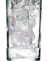 ICE MELTING IN A GLASS<br /> With condensation<br /> Water freezes at 0 deg C. or 32 deg F. at 1 atm.