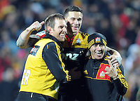 Chiefs Sonny Bill Williams, centre, celebrates with two of the trainers after the defeat over the Crusaders in the Super 15 Rugby semi final match, Waikato Stadium, New Zealand, Friday, July 27, 2012. Credit:SNPA / Ross Setford