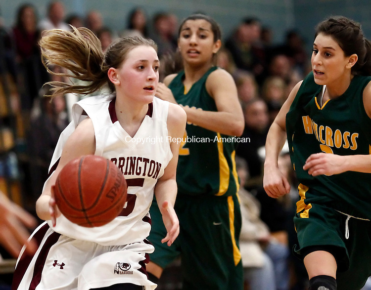 Waterbury, CT-  February 2013-021913CM11-  Torrington's Caroline Teti , left, takes the ball around Holy Cross' Amy Stafford during the NVL semifinals Tuesday night at Kennedy High School in Waterbury.  Torrington won, 40-34 and advanced to the NVL finals to face Watertown.     Christopher Massa Republican-American