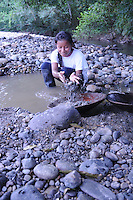Quichua guide Rawje's relatives panning for gold in the Rio Napo.<br />