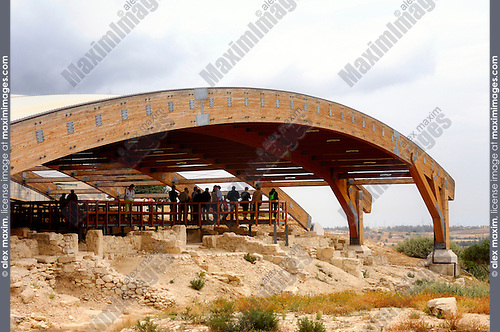 Travel stock photo of a Group of tourist under a wooden protective structure examining archeological dig at Kourion Archaeological Site in Cyprus Spring 2007 Horizontal
