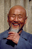 April 1985, China --- Portrait of Laughing Chinese Man --- Image by &copy; Owen Franken/CORBIS