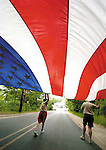 Sentinel/Dan Irving.Boy Scouts from Holland Troop #29 carry a large US flag into downtown Saugatuck for the annual Independence Day parade Monday..(7/4/05)