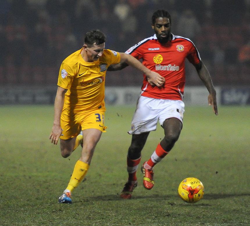 Crewe Alexandra's Anthony Grant holds off the challenge from Preston North End's Alan Browne<br /> <br /> Photographer Craig Thomas/CameraSport<br /> <br /> Football - The Football League Sky Bet League One - Crewe Alexandra v Preston North End - Sunday 28th December 2014 - Alexandra Stadium - Crewe<br /> <br /> &copy; CameraSport - 43 Linden Ave. Countesthorpe. Leicester. England. LE8 5PG - Tel: +44 (0) 116 277 4147 - admin@camerasport.com - www.camerasport.com