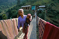 Peasant woman on the Sulichour bridge in Rolpa District, Nepal