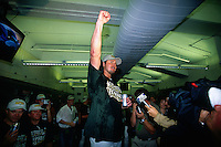 OAKLAND, CA - Jason Giambi of the Oakland Athletics celebrates in the clubhouse after a game in which the A's clinched the American League Western Division at the Oakland Coliseum in Oakland, California in 2000. Photo by Brad Mangin
