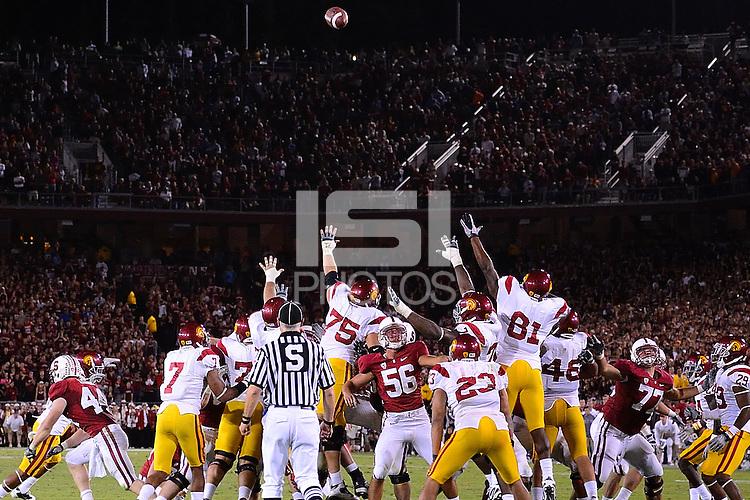 STANFORD, CA - SEPTEMBER 4: Nate Whitaker of Stanford football kicks the game-winning field goal against the USC Trojans on October 9, 2010 at Stanford Stadium / Foster Field in Stanford, CA.  Stanford won 37-35.