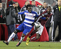 Ugo Ihemelu#3 of FC Dallas holds onto Omar Cummings#14 of the Colorado Rapids during MLS Cup 2010 at BMO Stadium in Toronto, Ontario on November 21 2010.Colorado won 2-1 in overtime.