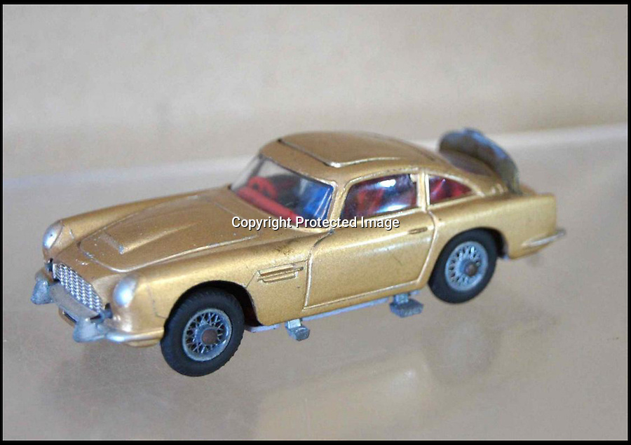 BNPS.co.uk (01202 558833)<br /> Picture:GregDiffin/BNPS<br /> <br /> A pack of James Bond cars made by toy maker Corgi that should have been sold in 1964 have been discovered still in their original Cellophane wrapped boxes.<br /> <br /> The six toy versions of Bond's Aston Martin DB5 were made in the wake of the 1964 film Goldfinger, which was the first to feature the gadget-laden silver car.<br /> <br /> Corgi sprayed the model motors gold and included an ejector seat which projected a plastic figure of a villian through the roof at the flick of a switch, replicating a scene in the movie.