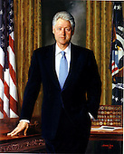 "United States President William Jefferson ""Bill"" Clinton is portrayed standing in the Oval Office next to the historic ""Resolute"" desk.  The gold damask draperies that hung in his office provide a backdrop for the American and presidential flags, as well as a display of military coins presented by units of the armed forces during his presidency.  Artist Simmie Knox painted this likeness in 2001 from sittings in the Oval Office and in the Clinton home in Washington, D.C.   The portrait was unveiled at a White House ceremony in Washington, D.C. on June 14, 2004.  .Credit: Ron Sachs / CNP"