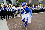 The Duke Blue Devil struts his stuff to the beat of the marching band during the Blue Devil Walk as fans cheer on. Duke faculty and staff helped cheer on the Blue Devils during the Employee Kickoff Celebration and season opener against North Carolina Central University. Duke won the game 49-6 at the newly renovated Brooks Field at Wallace Wade Stadium.