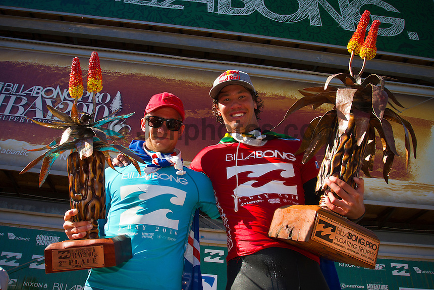 "Adam Melling (AUS) and Jordy Smith (ZAF).   JEFFREYS BAY, South Africa (Sunday, July 18, 2010) - Jordy Smith (ZAF), 22, has claimed his maiden ASP elite victory, taking out the Billabong Pro Jeffreys Bay over Adam Melling (AUS), 25, in front of a capacity hometown crowd..Event No. 4 of 10 on the 2010 ASP World Tour, the Billabong Pro Jeffreys Bay was nothing but blaring Vuvuzelas and roars from the bluff as these two titans went tit-for-tat in an incredible Final exchange. The young South African proved the victor, dominating from the outset and securing an emotional first win..""This is the best day of my life,"" Smith said. ""The crowd on the beach has been supporting me the last few days and hearing the cheers and the Vuvuzelas just gets me fired up to perform. It feels like they're pushing me along. I couldn't have done it without them."".The most experienced surfer at Jeffreys Bay, Smith left very little to chance in the Final against Melling, opening his account with a blazing 8.90 before backing it up with some scintillating forehand surfing for a 9.03. The combination of scores (17.93 out of a possible 20) proved insurmountable for Melling.  Photo: joliphotos.com"