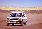 Arabs in old car on the road in desert in Egypt