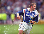 Ian Durrant chased around the park by water bombing keeper Andy Goram.Scottish Cup Final 1996