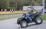 Tanner Horton rides his ATV to the football game at Leslie County High School in downtown Hyden, Ky., on Thursday, October 10, 2013. Photo by Emily Wuetcher
