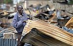 A man scavenges sheets of charred tin roofing from the ashes of what was once the central market in Bor, a city in South Sudan's Jonglei State that has been the scene of fierce fighting in recent months between the country's military and anti-government rebels. After fighting broke out in mid December 2013, control of the town changed hands four times in a few weeks. ACT Alliance members were among the first humanitarian agencies to enter the city in January 2014, and are providing services to thousands of people who are cautiously returning home to the troubled city.