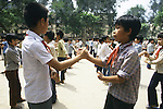 Students exercise in the Dong Da primary school exercise yard before attending classes in Hanoi, North Vietnam.  (Jim Bryant Photo).....