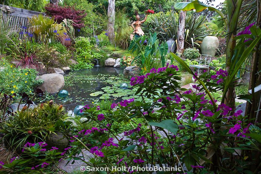 Garden pond framed by New Guinea Impatiens in California cottage garden with sculpture and decorative urn; Sherry Merciari garden