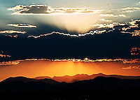 photographed summer 2006; sun setting over the Rocky Mountains