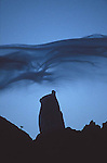 A silhouette of the summit of Cerro Torre<br /> with a whispy cloud hanging over the summit. Fitzroy wilderness, Argentina