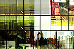 The abstract reflection of a house facade in a glass facade of another building