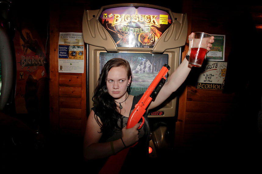 Lisa Roberts, 25, poses for a portrait at The Black Bear Lodge in Manhattan, which hosted an official Big Buck Party on Thursday April, 28, 2011. Fans of the popular hunting arcade game were invited to test their skill against other Big Buck Hunter fans to compete for prizes, enter to win raffle merchandise and meet Big Buck Girls...Danny Ghitis for The New York Times